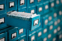 Old library or archive reference catalogue with opened card drawer. Stock Images