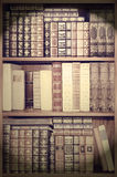 Old library,  cover books on shelves Royalty Free Stock Photography