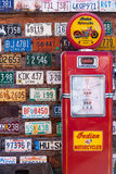Old license plates and gas pump Royalty Free Stock Images