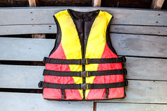 Old life jackets on the floor wooden boat Royalty Free Stock Photography
