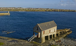 Old Lifeboat Station And Lighthouse At Wick Harbour, Caithness,Scotland.UK. Stock Photography