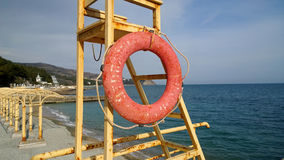 Old lifesaving station on the Black sea shore with a lifeline. Stock Photos