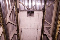 Free Old Lift Shaft With Counterweight. Lift Reconstruction. Industrial Object. Close-up Stock Photos - 102412593