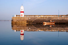 Old Lighouse and Boat with Sea Water Replection Stock Photo