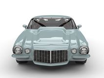 Old light blue classic vintage American car - front view. Isolated on white background Royalty Free Stock Images