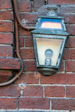 Old light on a brick wall Royalty Free Stock Images