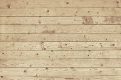 Old light brown wooden fence background texture. Close up Stock Photos