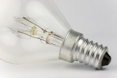 Old light bulb. With artfully shaped filaments Stock Images