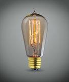 Old light bulb over gray background Royalty Free Stock Images