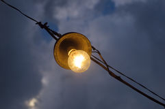 Old Light bulb on the sky Stock Images