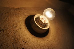 Old light bulb on the wall. Stock Image