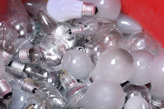 Old Light Bulbs in garbage can Royalty Free Stock Photo