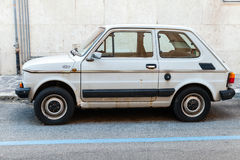Old light gray Fiat 126 parked on a roadside Stock Image