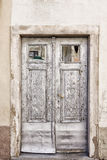 Old light grey double doors. With windows Stock Images