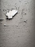 Old light grey painted wall background. Cracked wall Stock Images