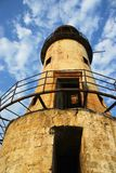 Old light house. Beautiful old light house against the blue sky Stock Image