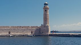 Old light house in the harbour off Rethymnon, Crete Greece royalty free stock photo