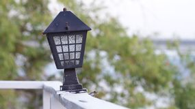 Old light lamp. Is on the wood wall near the choapaya river at Ayuttaya in Thailand stock image