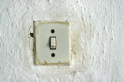 Old light switch. Traditional old light switch on the wall Stock Photo