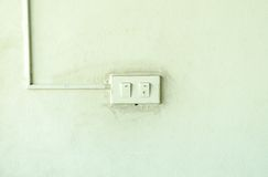 Old light switch on the green wall Stock Images