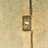 Old light switch on a grunge wall Stock Photography