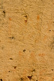 Old light umber Italian Stucco wall texture background. High res  old light umber  Stucco wall with cracks texture background from a small town in Italy Royalty Free Stock Photos