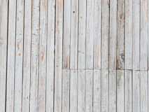 Old light wall covered with boards Stock Photos