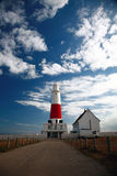 Old Lighthouse. Lighthouse on a Seashore - Cloudy Skies stock photos