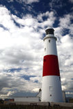 Old Lighthouse. Lighthouse on a Seashore - Cloudy Skies stock photography