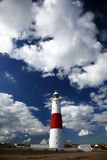 Old Lighthouse. Lighthouse on a Seashore - Cloudy Skies stock images