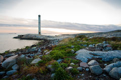 The old lighthouse 2. An old lighthouse on the swedeish coastline. The small island is named Fot Stock Photo