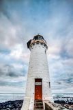 Old Lighthouse. A lighthouse with dramatic clouds in the background Stock Photos