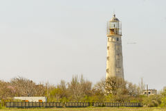 Old lighthouse on the background of bright sky. Old lighthouse on the background of the bright sky Stock Photography