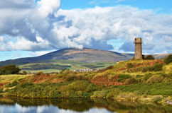 Old lighthouse and Black Combe near Millom. Royalty Free Stock Photo