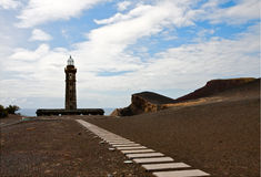 Old lighthouse Capelinhos on island Faial, Azores Royalty Free Stock Images