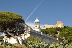 Old lighthouse. On the Catalan coast in the thickets of cactus Royalty Free Stock Images