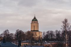 Old lighthouse and church in a winter or spring day, Helsinki Finland royalty free stock image