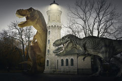 Old Lighthouse. Dinosaur scene of the two dinosaurs fighting each Royalty Free Stock Images