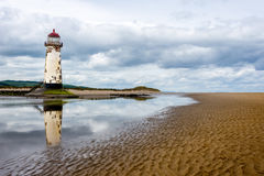 Old lighthouse. Old disused abandoned lighthouse. leaning over on the beach like the tower of Pisa, but maybe not as far just yet. located in Talacre, north stock images