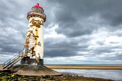 Old lighthouse. Old disused abandoned lighthouse. leaning over on the beach like the tower of Pisa, but maybe not as far just yet. located in Talacre, north stock photo
