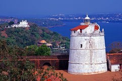 Old Lighthouse and Fort. Old Portuguese Lighthouse and Fort Aguada Overlooking Arabian Sea in Goa, India Stock Photos