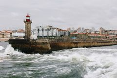 Old lighthouse and granite pier at the mouth of Douro river, Porto. Portugal stock photo