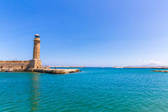 Old lighthouse at harbor. Rethymno, Crete, Greece Royalty Free Stock Images