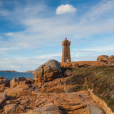 Old lighthouse on the impressive coast in Brittany Stock Photography