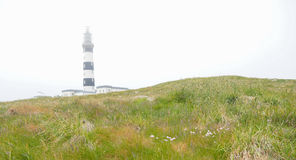 Old lighthouse on island of Ushant, or Ouessant, brittany France Royalty Free Stock Photo