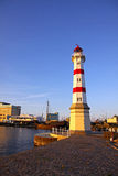Old lighthouse in Malmo city, Sweden. Old lighthouse in Oresund strait, Malmo city harbor, Sweden Stock Photo