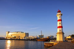 Old lighthouse in Malmo city, Sweden. Old lighthouse in Oresund strait, Malmo city harbor, Sweden Stock Photos