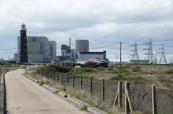 Old lighthouse and modern nuclear power station at Dungeness UK Stock Photos