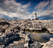 Old lighthouse on the Murro di Porco cape Royalty Free Stock Photography