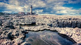 Old lighthouse on the Murro di Porco cape Stock Photo